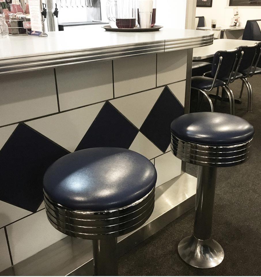 Classic-retro-diner-lunch-counter-and-stools