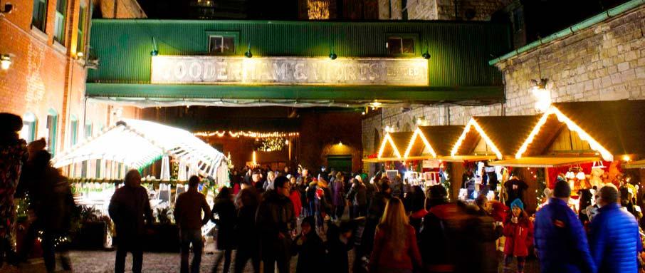 Crowds-stroll-through-distillery-Toronto-Chriistmas-Market-at-night