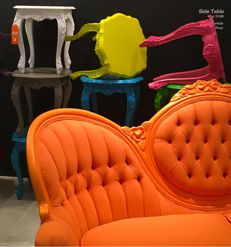 Funky-colourful-side-tables-and-orange-couch-on-display-at-High-Point-Market