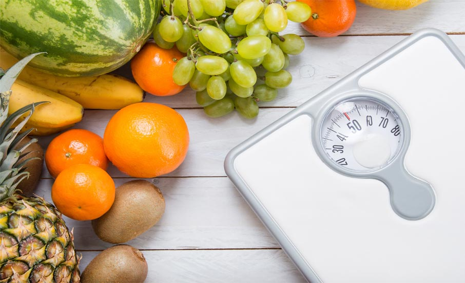 Good-health-with-eating-fresh-food-fruits-and-watching-weight-bathroom-scale