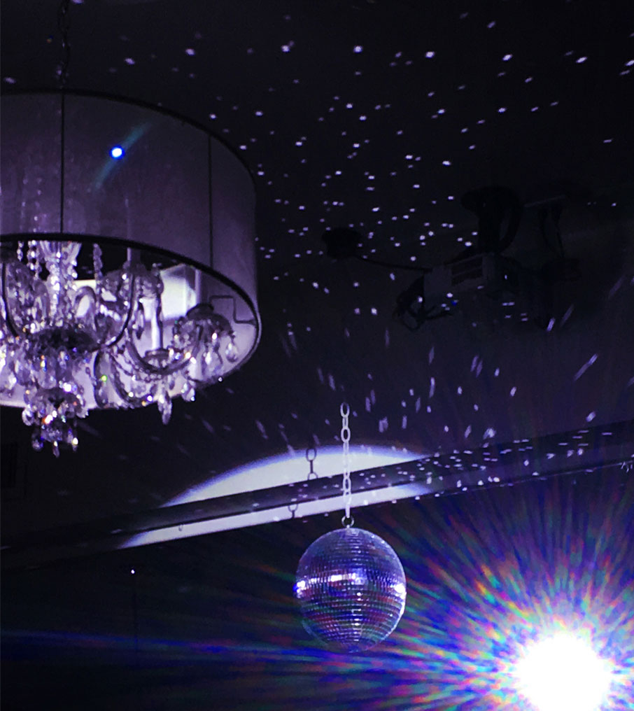 Grand-Winter-Ball-chandelier-and-disco-ball-mood-lighting
