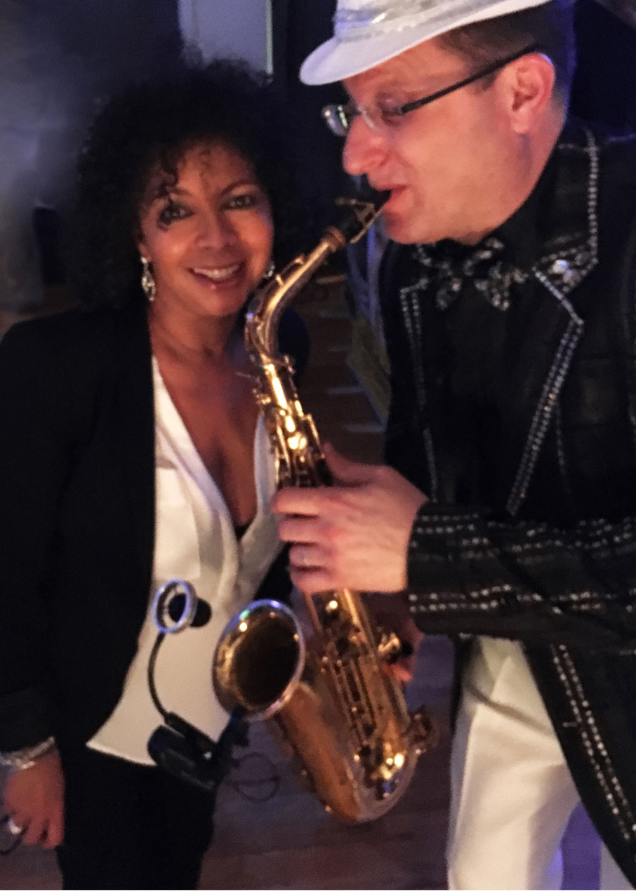 Grand-Winter-Ball-saxophone-player-entertains-Sharon-Lockwood