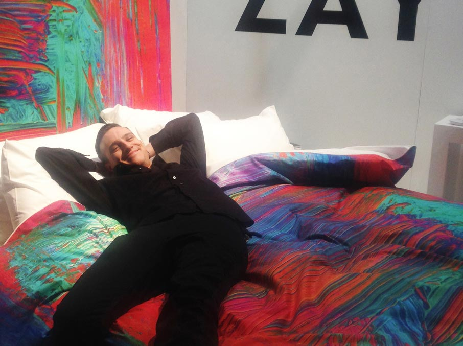 IDS-2016-show-attendee-relaxing-on-ZayZay-exhibit-with-Madagascar-duvet-cover