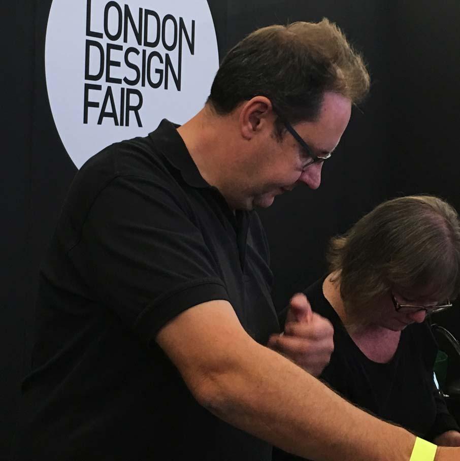 London-Design-Fair-sign-behind-staff