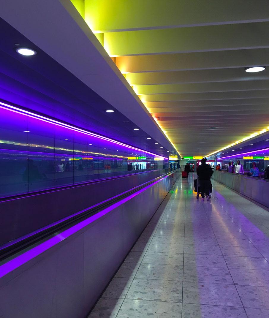 London-Design-Festival-coloured-lights-in-Heathrow-passageway