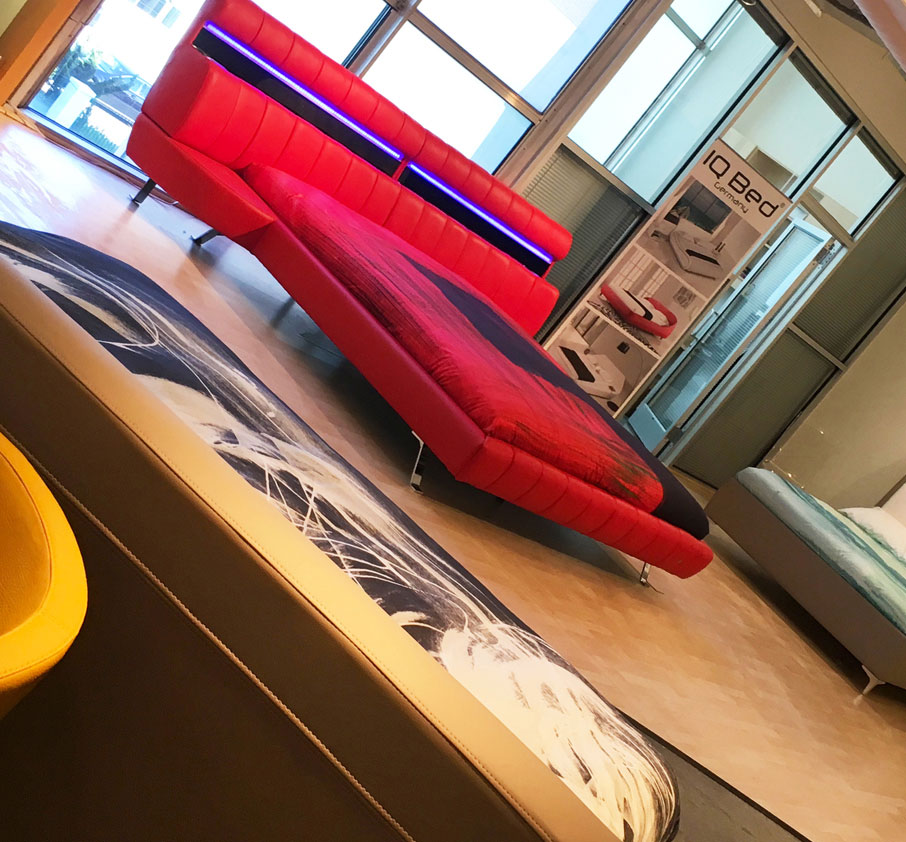 Mercatus-showroom-High-Point-Market-featuring-IQ-beds-with-ZayZay-duvet-covers