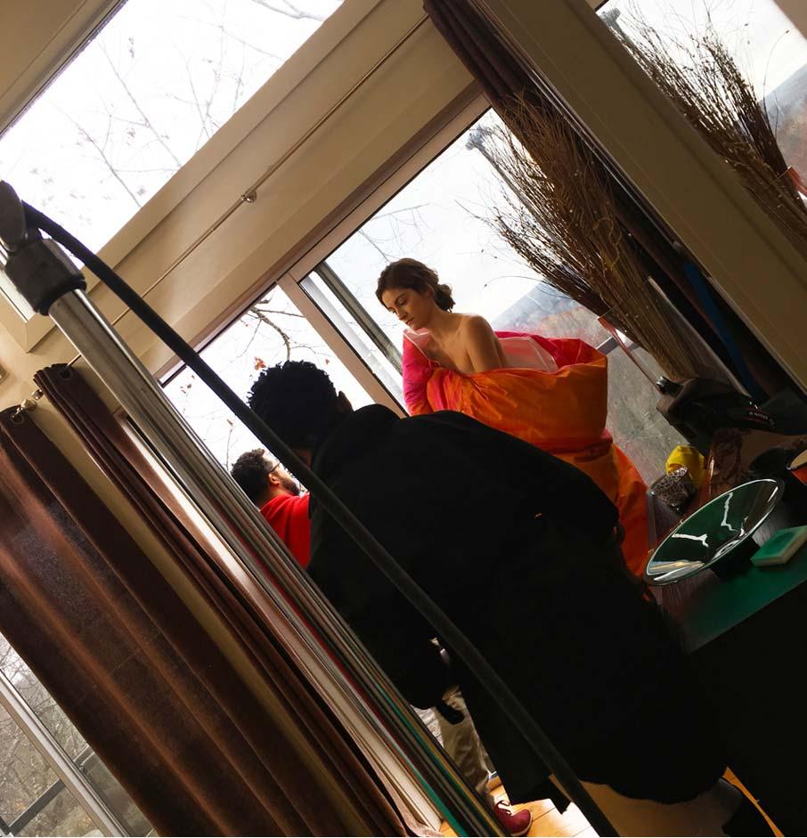 Model-wrapped-in-Saffron-Shangri-lahh-duvet-cover-preparing-for-videoshoot