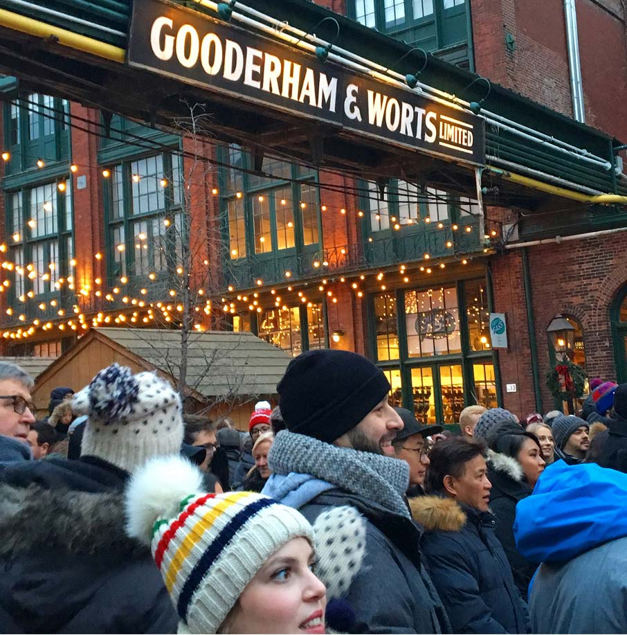 Toronto-Christmas-Market-crowd-under-Gooderham-and-Worts-sign