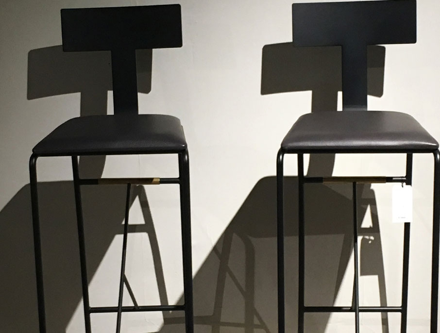 Two-minimalist-designer-bar-chairs-at-High-Point-Market