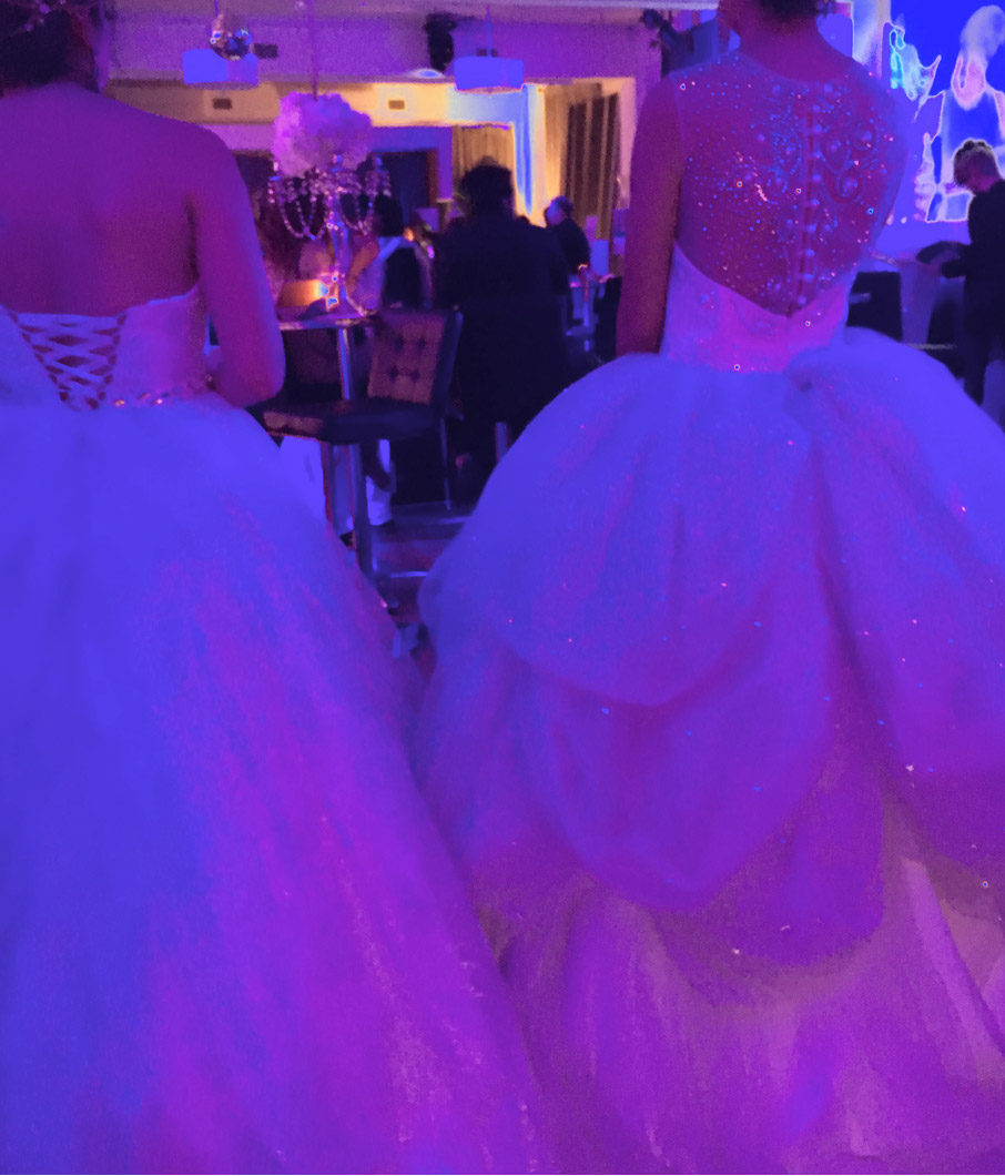 Two-women-wearing-glamourous-white-gowns