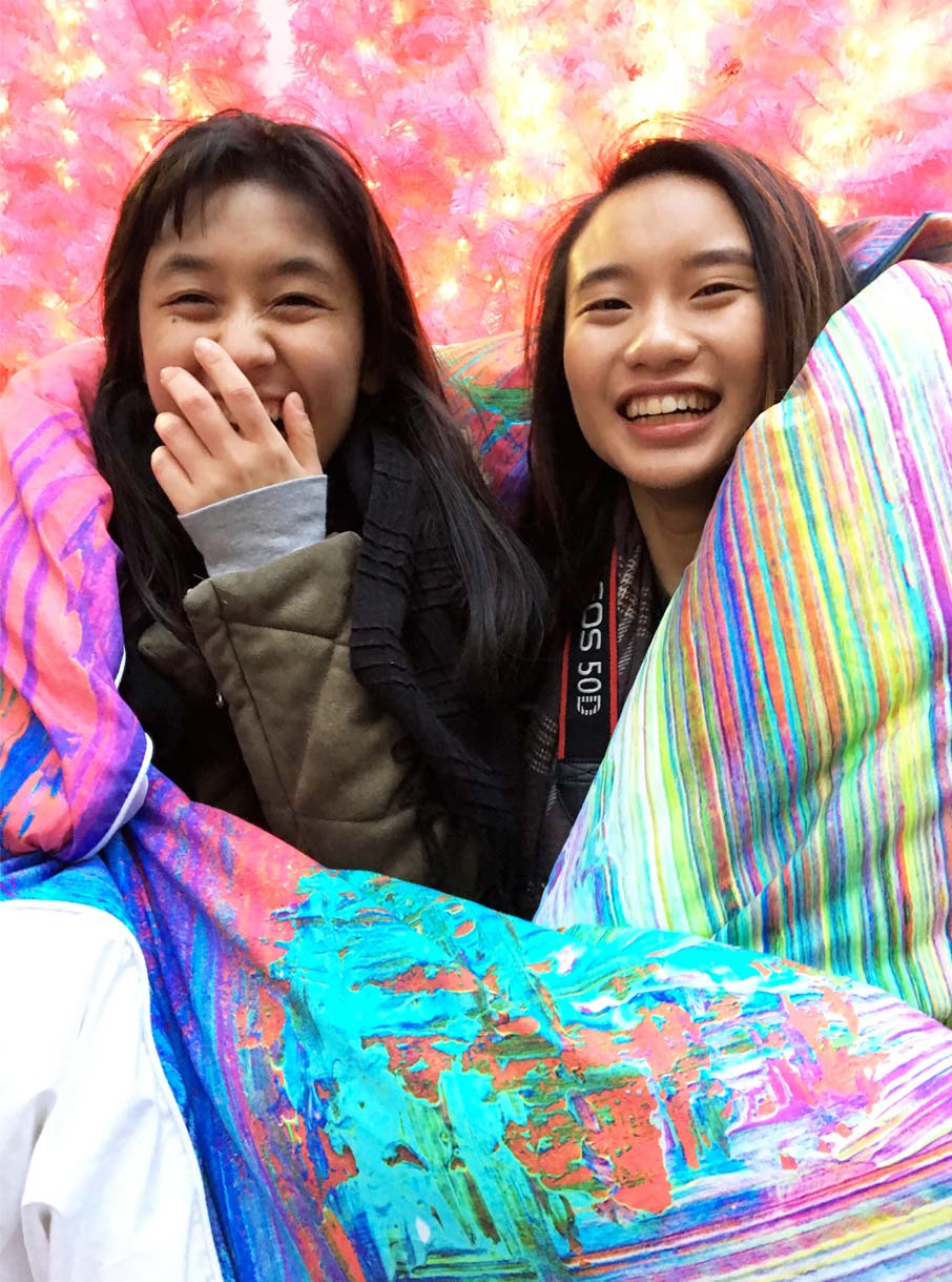 Young-Asian-girls-laughing-while-wrapped-in-ZayZay-Madagascar-duvet-cover