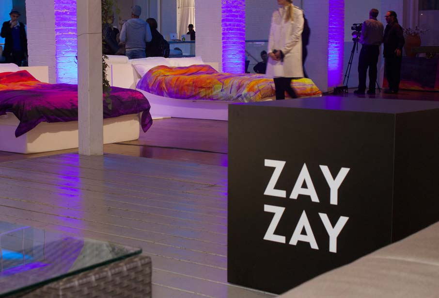 ZZ-B-Launch-party-ZayZay-black-cube-in-foreground-two-duvet-covers-on-beds-behind