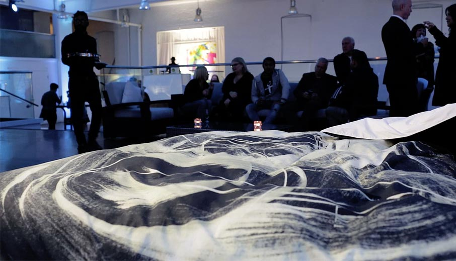 ZZ-B-Zayay-launch-party-Realm-of-Rorschach-duvet-cover-in-foreground-guests-behind