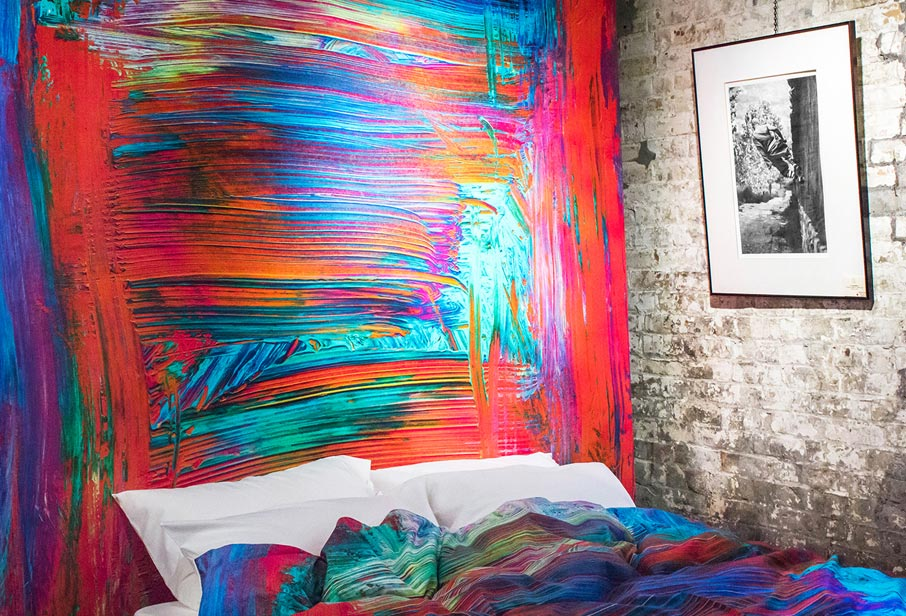 ZayZay-PopUp-Madagascar-duvet-cover-on-display-bed-and-as-wall-mural-hanging-on-wall-at-Arta-gallery