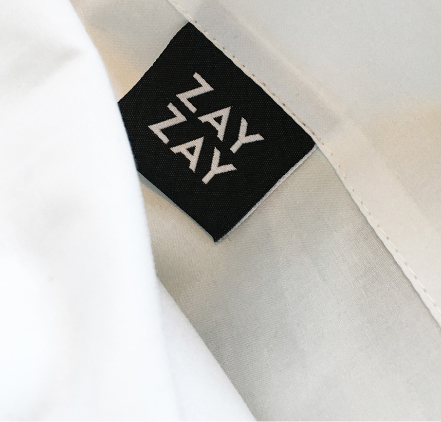 ZayZay-brand-label-in-white-sheet-on-display-at-High-Point-Market