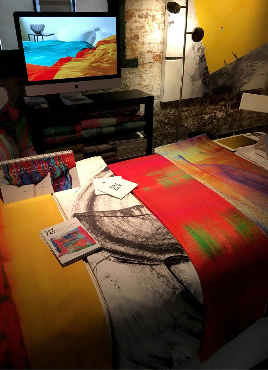 ZayZay-duvet-cover-designs-on-table-and-Moroccan-Monday-on-monitor-behind-at-Arta-popup