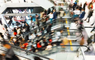 Blurred-escalators-packed-with-rushing-shoppers