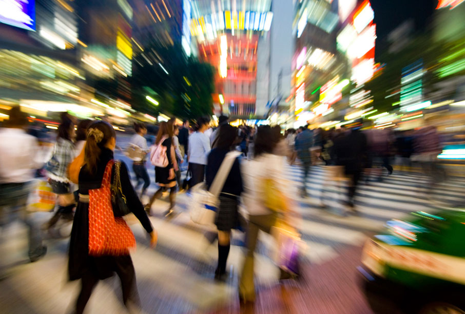 Blurred-zoom-view-of-shoppers-on-busy-street
