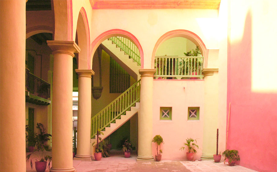 Cuba-interior-architecture-orange-and-pink-hues-columns-arches-staircase