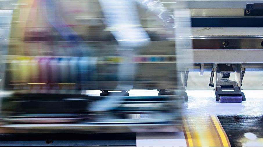 Digital-printer-blurred-motion-of-ink-printing-on-surface