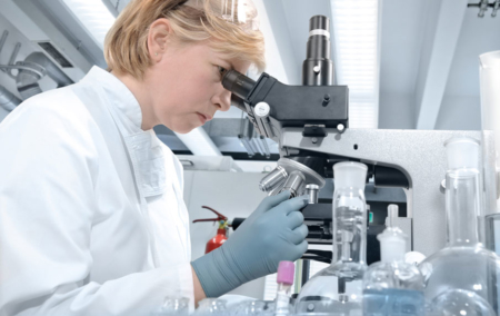 Lab-worker-looking-through-microscope