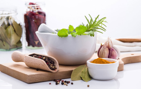 Spices-and-herbs-white-bowls-cutting-board