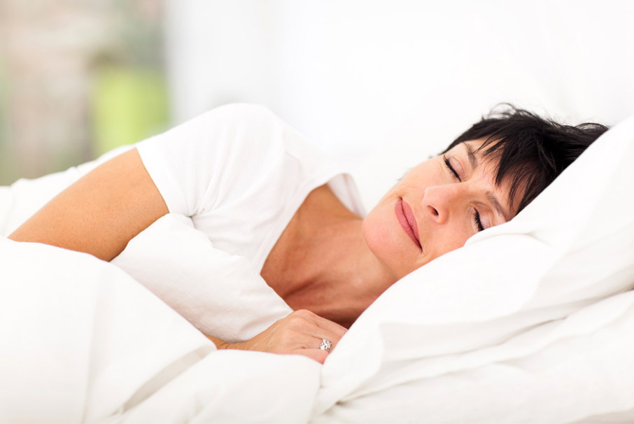 Woman-enjoying-morning-sleep-in-white-sheets