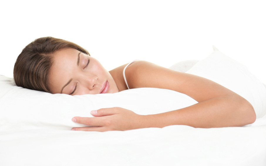Young-woman-sleeping-in-white-bed-linen