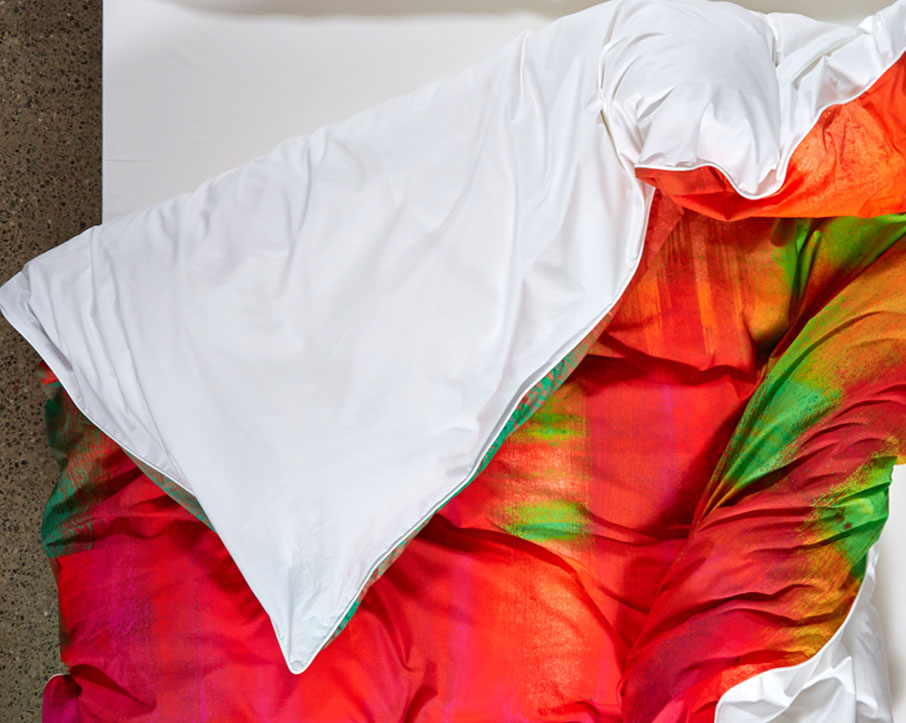 ZayZay-Apsara-Dance-duvet-cover-top-view-folded-back-on-bed
