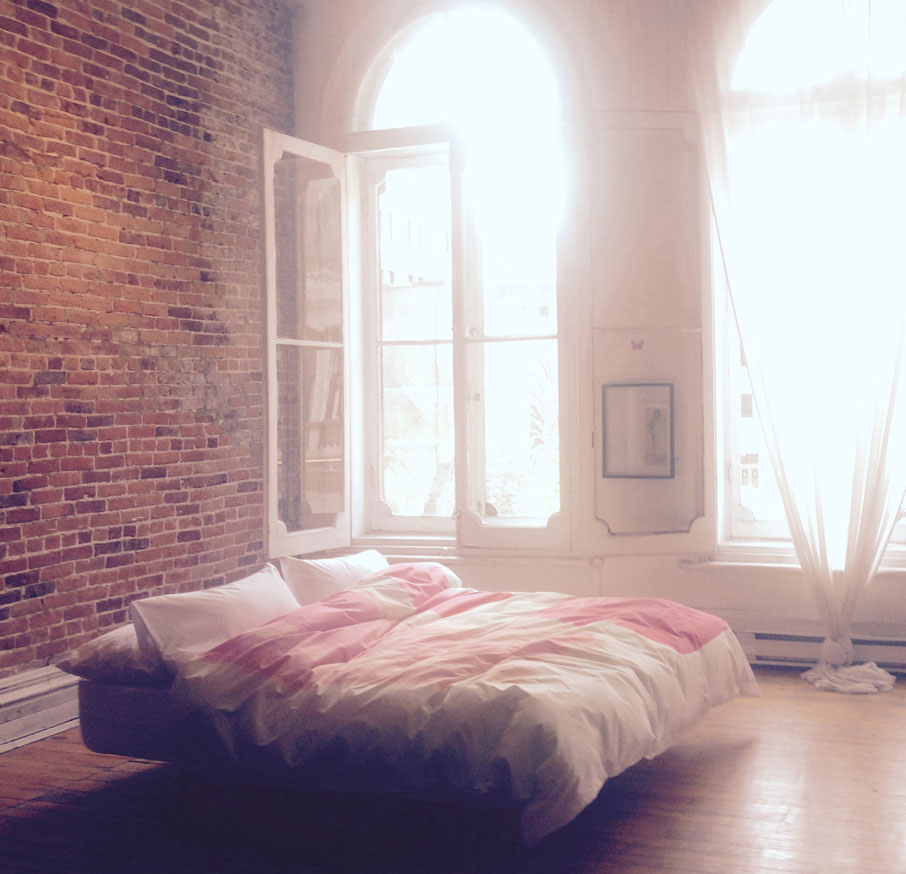 ZayZay-duvet-cover-design-So-Jess-featured-in-a-bedroom-with-brick-walls-and-tall-Victorian-white-frame-windows