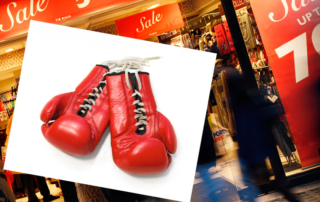 Boxing-gloves-on-top-of-store-with-red-boxing-day-sale-signs