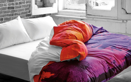 Saffron-Shangrilahh-duvet-cover-design-orange-and-purple-pulled-back-white-sheets-in-gray-bedroom