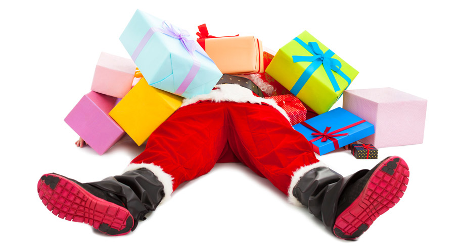 Santa-knocked-out-lying-on-ground-under-presents