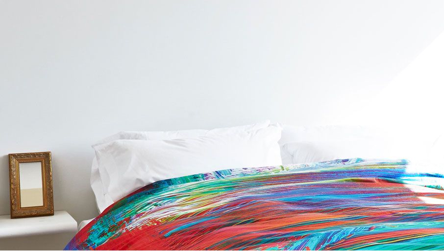 ZayZay Living duvet cover design Madagascar featuring multicolour brushstrokes on bed in bright room